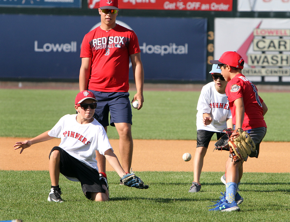 . Lowell Spinners and Eastern Bank hold kids\' baseball camp. Ground ball gets past David Comalli, 12, of Lowell. (SUN/Julia Malakie)