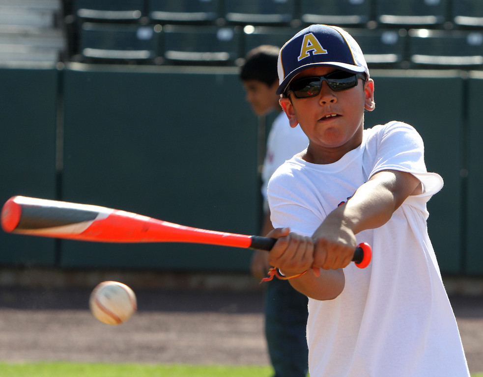 . Lowell Spinners and Eastern Bank hold kids\' baseball camp. Aaryan Deshwal, 11, of Andover, during batting practice. (SUN/Julia Malakie)