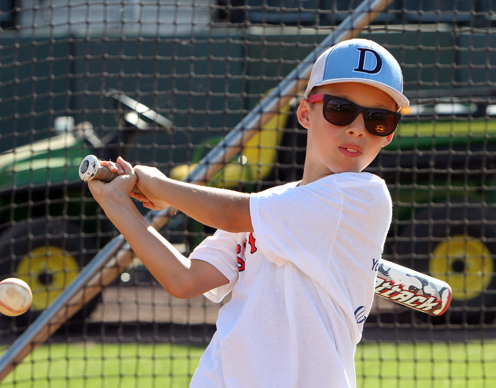 . Lowell Spinners and Eastern Bank hold kids\' baseball camp. Riley Johnson, 11, of Dracut, during batting practice. (SUN/Julia Malakie)