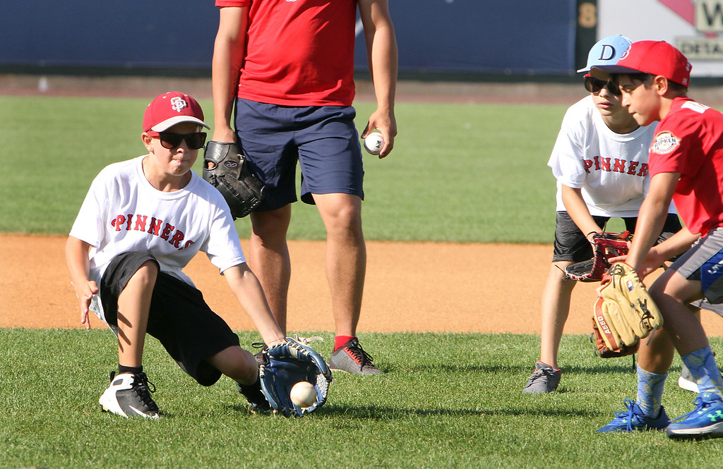 . Lowell Spinners and Eastern Bank hold kids\' baseball camp. From left, David Comalli, 12, of Lowell, Riley Johnson, 11, of Dracut, and Giacomo Berardinelli, 10, of Burlington. (SUN/Julia Malakie)