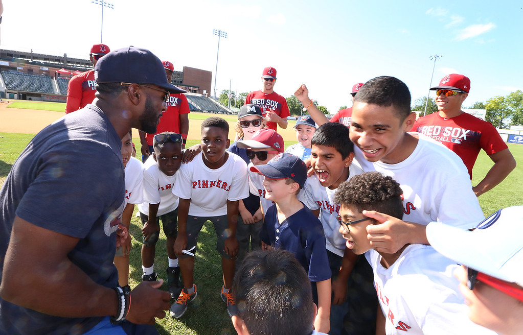 . Manage Corey Wimberly gives pep talk as Lowell Spinners and Eastern Bank hold kids\' baseball camp. (SUN/Julia Malakie)