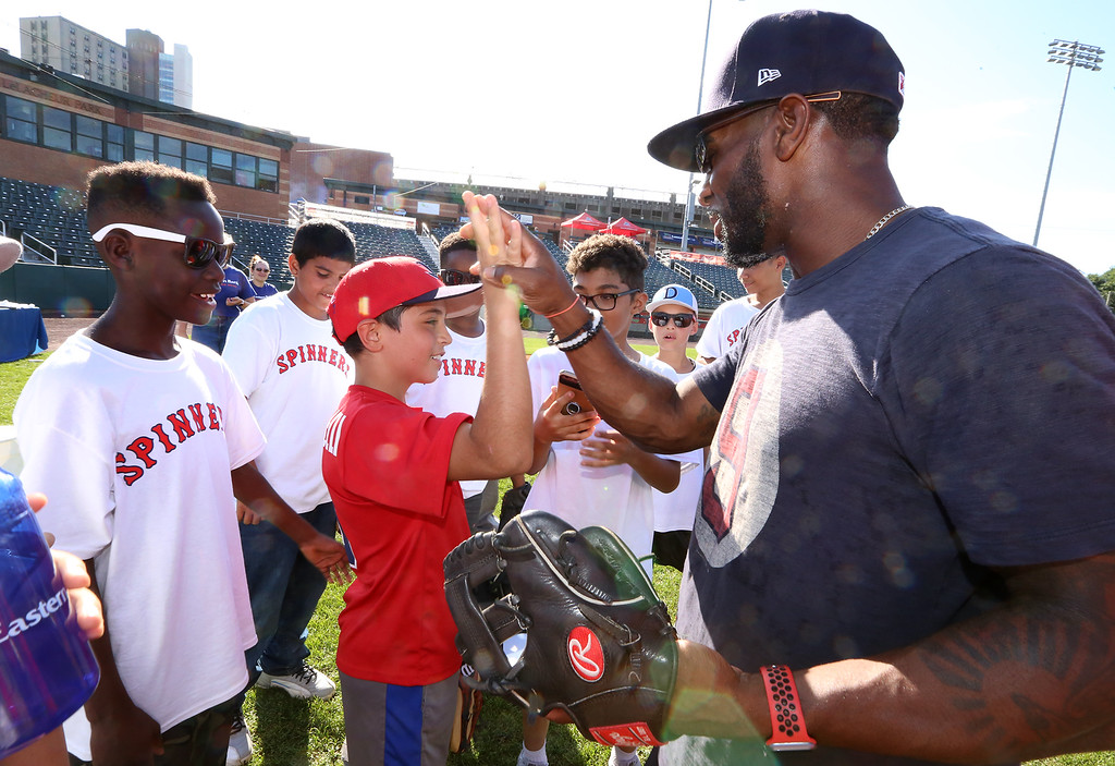 . Lowell Spinners and Eastern Bank hold kids\' baseball camp. Spinners manager Corey Wimberly congratulates Giacomo Berardinelli, 10, of Burlington, after his name pulled out of a hat to throw out the first pitch at that night\'s Spinners game. (SUN/Julia Malakie)