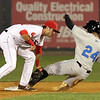 Lowell Spinners vs Hudson Valley baseball. Spinners shortstop CJ Chatham (21) tags out Hudson Valley's Garrett Whitley (24) trying to steal second in the top of the second inning. (SUN/Julia Malakie)