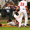 Lowell Spinners vs Hudson Valley baseball. Hudson Valley's Jim Haley (38) is tagged out in a rundown by Spinners catcher Isaias Lucena (20), rear, as shortstop CJ Chatham (21) looks on in the top of the third inning. (SUN/Julia Malakie)