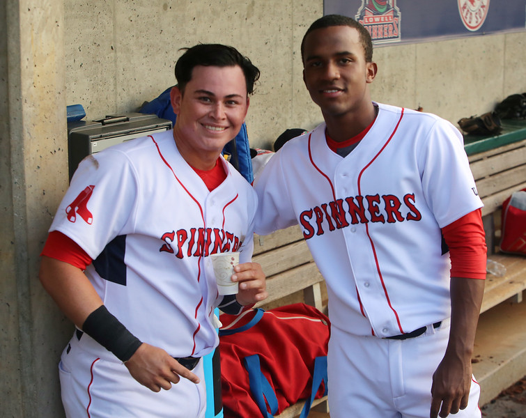 Lowell Spinners vs Connecticut Tigers baseball. Lowell's Raiwinson Lameda (28), left, with pitcher Yorvin Pantoja, in dugout after Lameda scored in the bottom of the third inning. (SUN/Julia Malakie)