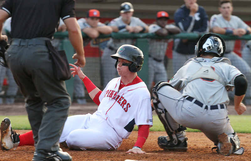 Lowell Spinners vs Connecticut Tigers baseball. Spinners' Brett Netzer (18) is safe at home, past Tigers catcher Joey MOrgan (9), scoring from second on a double by Raiwinson Lameda in the bottom of the third inning. (SUN/Julia Malakie)