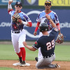 Lowell Spinners vs Connecticut Tigers baseball. Tigers' Luke Burch (29) is out at second on a fielder's choice as Spinners second baseman Brett Netzer throws to first, backed up by shortstopYomar Valentin. (SUN/Julia Malakie)