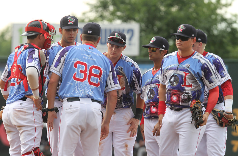 Lowell Spinners vs Connecticut Tigers baseball. Spinners catcher Samuel Miranda, pitcher Enmanuel DeJesus, second from right, pitching coach Lance Carter (38) and infield gather at the mound with two Tigers on base in the top of the second inning. (SUN/Julia Malakie)