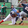 Lowell Spinners vs Connecticut Tigers baseball. Tigers baserunner Dylan Rosa (28) is safe at third with a stolen base as Spinners third baseman Garrett Benge (61) fields throw in the top of the second inning.  (SUN/Julia Malakie)