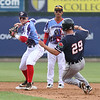 Lowell Spinners vs Connecticut Tigers baseball. Tigers' Luke Burch (29) is out at second on a fielder's choice as Spinners second baseman Brett Netzer throws to first, backed up by shortstopYomar Valentin, in the top of the third inning. (SUN/Julia Malakie)