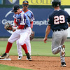Lowell Spinners vs Connecticut Tigers baseball. Tigers' Luke Burch (29) is out at second on a fielder's choice as Spinners second baseman Brett Netzer fields the throw, backed up by shortstopYomar Valentin, in the top of the third inning. (SUN/Julia Malakie)