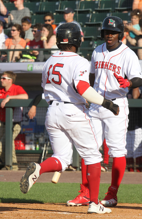. Lowell Spinners vs Connecticut Tigers baseball. Spinners\' Juan Carlos Abreu (15) scores in the bottom of the fourth inning, greeted by on deck batter Gilberto Jimenez (32). (SUN/Julia Malakie)