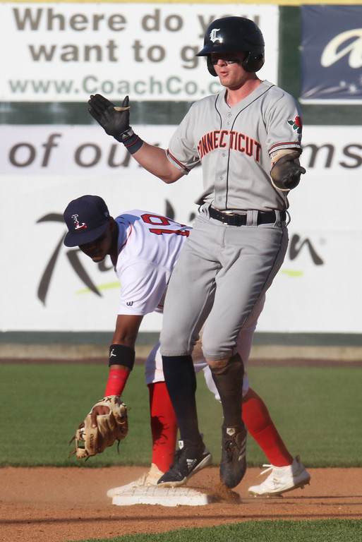. Lowell Spinners vs Connecticut Tigers baseball. Tigers\' Matt Jarecki (12) is safe at second with a double in the top of the fifth inning, with Spinners shortstop Antoni Flores (19) fielding the throw. (SUN/Julia Malakie)