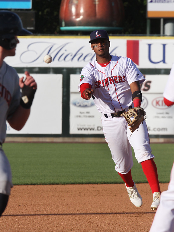 . Lowell Spinners vs Connecticut Tigers baseball. Spinners shortstop Antoni Flores (19) throws to third on a ground ball, too late to get the runner in the top of the fifth inning. (SUN/Julia Malakie)