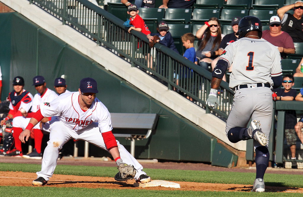. Lowell Spinners vs Connecticut Tigers baseball. Tigers\' Kelvin Smith (1) is out on an infield grounder, with first baseman Steve Pearce taking the throw from the pitcher. (SUN/Julia Malakie)