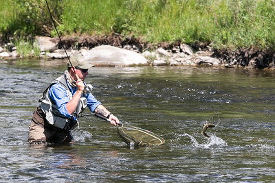 Filip Kuras, of Poland, prepares to land a fish out a section of the Eagle river in Wolcott Thursday during the FIPS Mouche World Youth Flyfishing Championship.  Scoring is based off of quantity and length of fish caught during five 3 hour sessions held over the course of a week.
