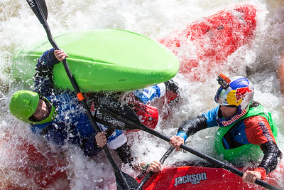 Maya Rosecrance, left, Claire O'Hara, underneath, and Noria Newman, right, get smashed and tangled together near the International Bridge while competing in the GoPro Mountain Games 8 ball full contact Kayak Sprint competition in Vail on Sunday. Coincidentally, all three of these ladies took the podium, with Noria Newman, of France, stepping to the top spot.
