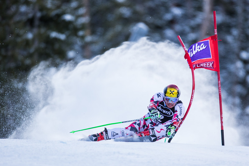 Austria's Marcel Hirscher hugs a gate at Screetch Owl during the Birds of Prey giant slalom race on Sunday.  Hirscher climbed to the top of the podium yet again to claim first place for the Austrians with a final combined time of 2 minutes, 32.58 seconds.