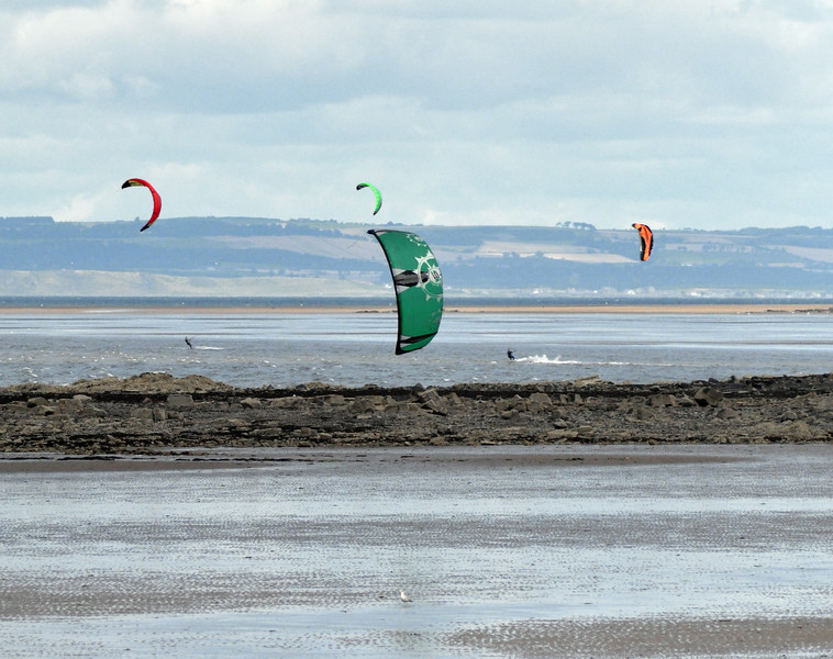 Four kite surfers
