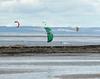 Four kite surfers