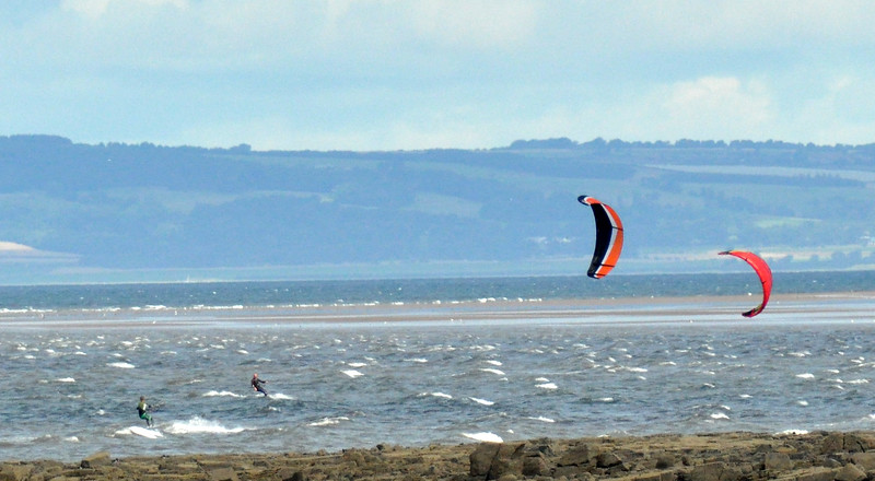 A pair of kite surfers