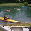 A beginner masters a workout kayak.