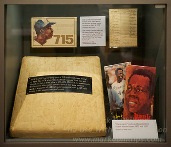 "Exhibit of items from Atlanta Fulton County Stadium on April 8, 1974 when Henry ""Hank"" Aaron hit his 715th homerun to pass Babe Ruth as the all-time leader for homeruns. National Baseball Hall of Fame in Cooperstown, New York"