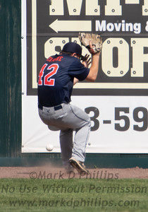 North Shore Navigators center fielder Ryan Cervone, a sophmore at Northeastern University, loses the ball on a drive to the wall  during  FCBL game with the Nashua Silver Knights at Holman Stadium in Nashua, NH
