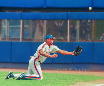 New York Mets RF Bobby Bonilla dives for a ball hit by Chicago Cubs Sammy Sosa on Sunday, August 2, 1992, at Shea Stadium. Bonilla injured his knee and missed the catch with Sosa recording a triple and going on to score in the Mets 4-2 victory.