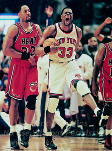 New York Knicks Patrick Ewing celebrates against the Miami Heat Alonzo Mourning