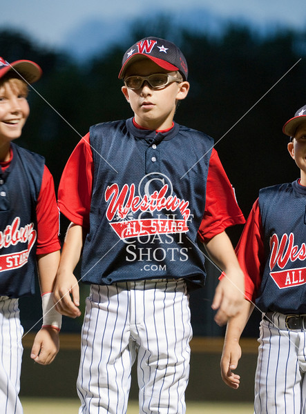 West University Little League's National All-Stars matched up with Westbury Little League's All-Stars for an evening game to open the District 16 playoffs. WULL won 16-3.
