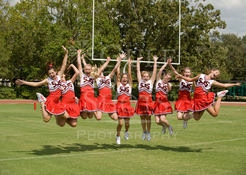Houston-based St John's School 8th grade girls cheerleaders perform and pose at a middle-school makeup football game rescheduled to a Saturday mid-day due to Hurricane Ike. The cheering worked, the Mavs won.