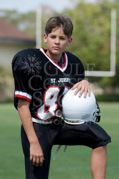 Houston's Saint John's School Middle School 8th grade Football Team poses for individual and team portraits