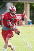 The Mavericks of St. John's School's boys varsity lacrosse team hosts nearby Episcopal High School's Knights. An overflow crowd saw the boys play to double overtime, where SJS won by sudden death, 8-7.