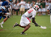 The Mavericks of St. John's School's varsity boys lacrosse team hosts nearby rival Episcopal High School's Knights in the citywide semifinals under on-and-off rain.  SJS won 4-3.
