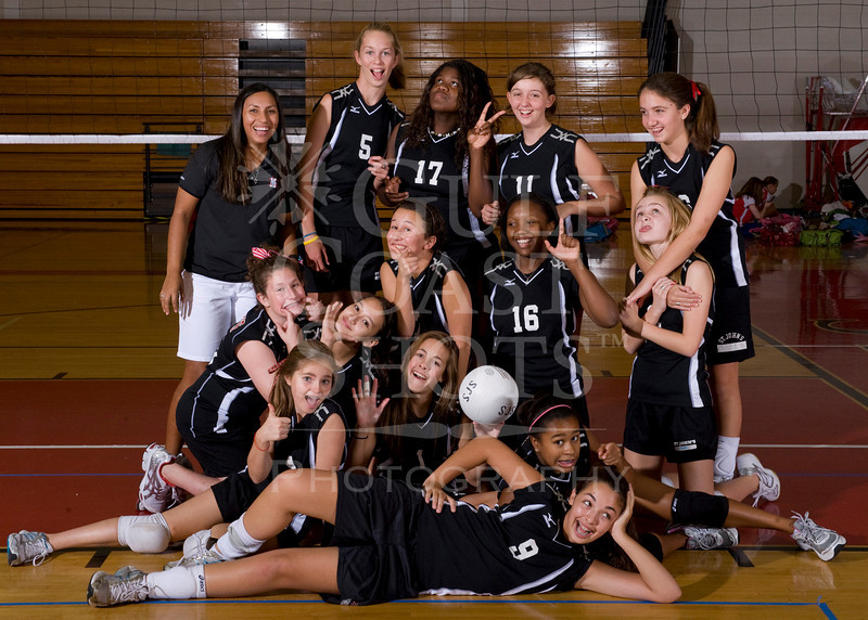 Houston's Saint John's School Middle School 8A Girls Volleyball Team poses for team portraits.