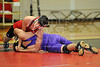 Houston-based St. John's School upper-school varsity and JV wrestling teams host next-door Lamar High School for an evening wrestling meet. SJS extended their perfect season with a win.