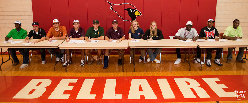 Eight high-school atheletes from Bellaire High School, Bellaire Texas sign scholarship obligations to play college athletics.
