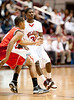 The Tigers of Travis High School play Bellaire's Cardinals in the semi-finals of the Texas UIL's men's basketball playoffs for region 3.  Bellaire won, advancing to the finals.