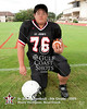 St. John's 8th grade football team poses for individual and team portraits