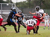 Houston Christian High School hosts St. John's School for JV football under the threat of continued rain, and soggy field conditions.  SJS prevailed, 27-0.