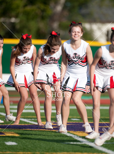 Cheerleaders from St. John's School perform an after-game routine at Kinkaid following the JV football game between the Mavericks and Falcons.