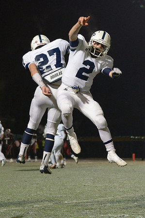Waltham: St. John's Prep captains Alex Moore (27) and Jack Sharrio (2) celebrate one of the Eagles' seven TDs in the D1 Super Bowl win over Brockton. Mark Teiwes photo.