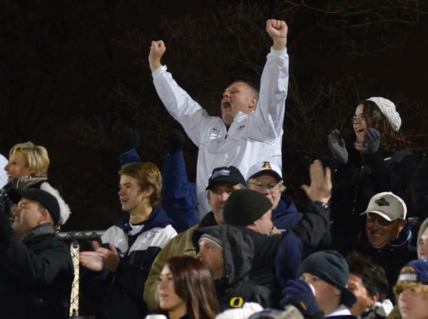 Waltham: St. John's Prep fans celebrate a touchtown. Mark Teiwes photo.