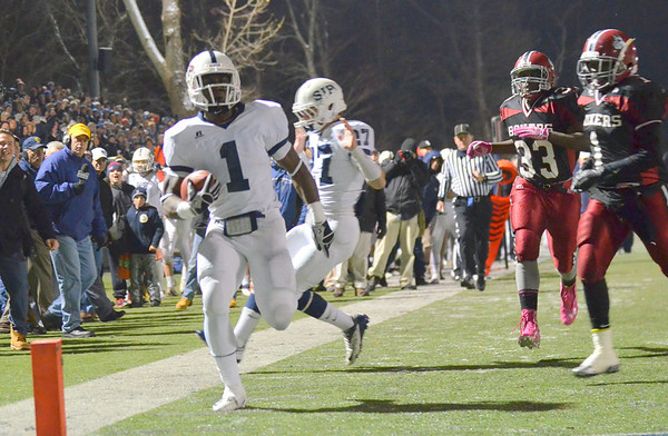 Waltham: Johnny Thomas cruises into the end zone just 65 seconds into the D1 Super Bowl. The Eagles never looked back, crushing Brockton 48-28. Mark Teiwes photo.