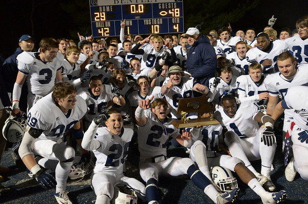 Waltham: The St. John's Prep football team celebrate their state championship victory over Brockton. Mark Teiwes photo.