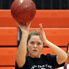 Beverly: Beverly senior Mary Cate Flaherty takes a shot at practice on Thursday evening. Flaherty and 5 other seniors will provide veteran leadership for the 2013-2014 Panthers squad. DAVID LE/Staff Photo