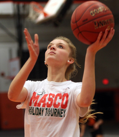 Beverly: Beverly senior Bridget Keaton glides in for an easy layup at practice on Thursday evening. DAVID LE/Staff Photo