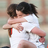 Beverly: Beverly senior captain Kristen O'Connor, right, gets swept up in a big hug from fellow senior captain Casey Cook after the Panthers beat Peabody 3-2 to earn a share of NEC Large Title on Friday afternoon. David Le/Salem News