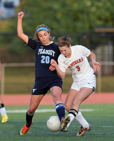 Beverly: Peabody senior captain Madison Doherty (20) challenges Beverly senior captain Diandra Crowley (9) during the second half of play on Friday afternoon. David Le/Salem News